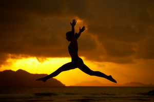 Woman jumping in Sunset